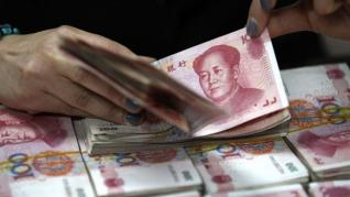 Businesses should get ready for more volatility in the Chinese yuan, regulator says