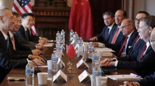 China ready to discuss a partial trade deal and will increase US agricultural purchases, reports say